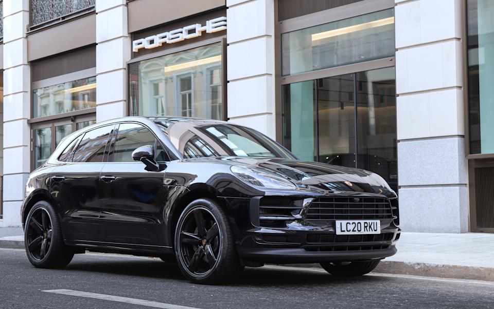 LONDON, UNITED KINDOM - AUGUST 09: The Porsche Macan S seen outside a Porsche dealership in Mayfair, London. The Macan S is their midrange model placing it ahead of the Macan, but before the Macan GTS and Turbo models. (Photo by Martyn Lucy/Getty Images)