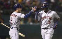 Houston Astros' Martin Maldonado, right, celebrates with Alex Bregman after hitting a home run off Oakland Athletics' Edwin Jackson during the fifth inning of a baseball game Friday, Aug. 17, 2018, in Oakland, Calif. (AP Photo/Ben Margot)