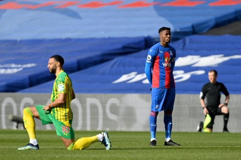 Taking a stand: Crystal Palace's Wilfried Zaha became the first Premier League player not to kneel prior to kick-off as a gesture in fighting against racial injustice