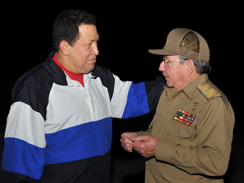 FILE - In this Dec. 10, 2012 file photo released by Cuba's state newspaper Granma, Cuba's President Raul Castro, right, receives Venezuela's President Hugo Chavez at the Jose Marti International airport in Havana, Cuba.  Chavez arrived in Cuba on Dec. 10, 2012 for a fourth cancer-related operation after designating Vice President Nicolas Maduro as his political heir. (AP Photo/Granma, File)