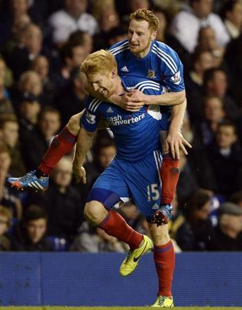 Hull City's Paul McShane (L) celebrates his goal against Tottenham Hotspur with Stephen Quinn during their English League Cup fourth round soccer match at White Hart Lane in London, October 30, 2013. REUTERS/Dylan Martinez