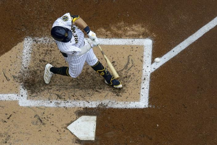 Milwaukee Brewers' Keston Hiura hits a home run during the third inning of a baseball game against the Colorado Rockies Sunday, June 27, 2021, in Milwaukee. (AP Photo/Morry Gash)