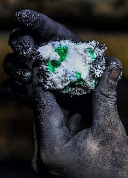 Sometimes guaqueros find sparkling green stones in a wash of shale, as a geologist shows here