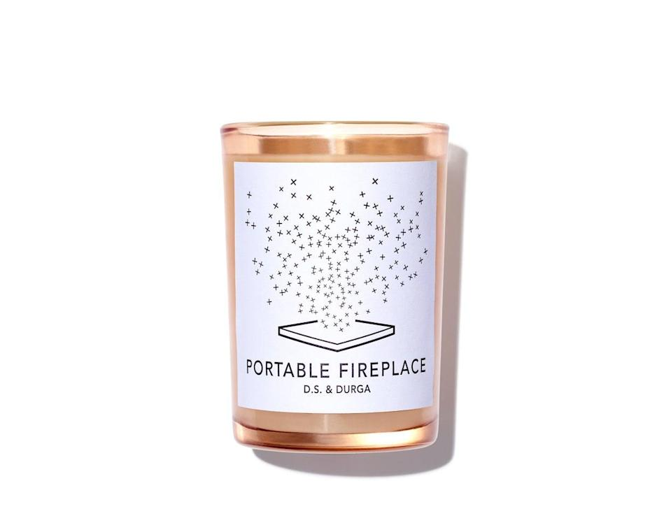 "<h3>D.S. & Durga Portable Fireplace Candle</h3> <br>If you're looking for an example of perfectly named candles, D.S. & Durga's Portable Fireplace is it. Snap up the cozy candle to make her time at home even <em>more</em> cozy.<br><br><strong>D.S. & Durga</strong> Portable Fireplace Candle, $, available at <a href=""https://go.skimresources.com/?id=30283X879131&url=https%3A%2F%2Fvioletgrey.com%2Fproduct%2Fportable-fireplace%2FDSG-DSC-129portable"" rel=""nofollow noopener"" target=""_blank"" data-ylk=""slk:Violet Grey"" class=""link rapid-noclick-resp"">Violet Grey</a><br>"