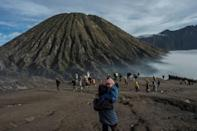 Every year people gather from the surrounding highlands to throw fruit, vegetables, flowers and even livestock into Mount Bromo's crater as part of the Yadnya Kasada festival