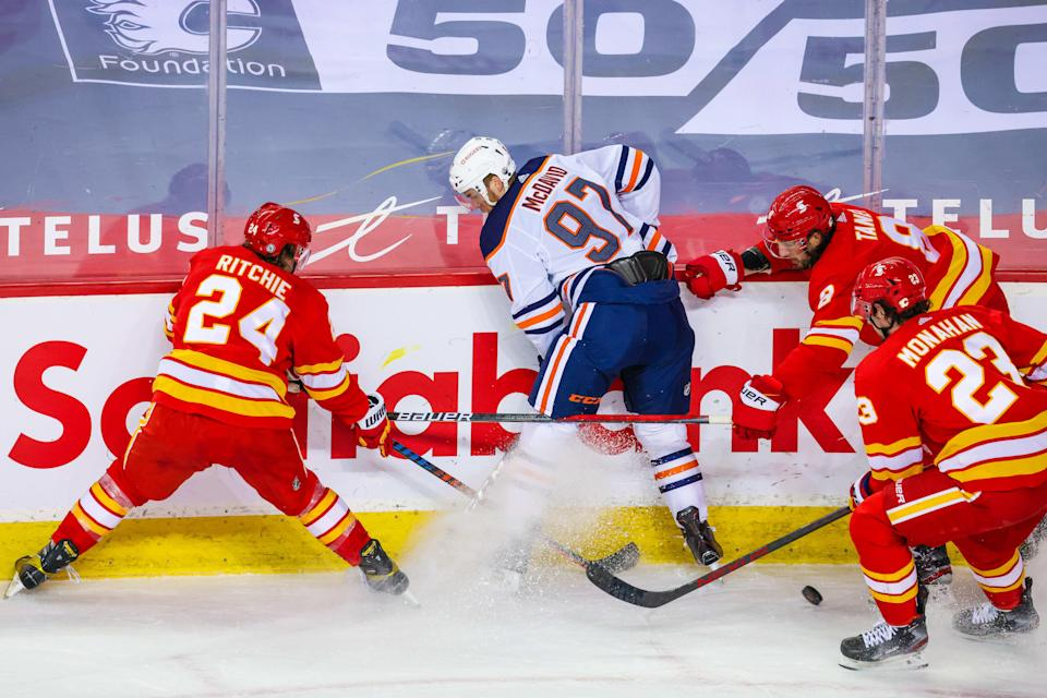 Connor McDavid and the Edmonton Oilers played the Calgary Flames hours after a memorial service for teammate Colby Cave.