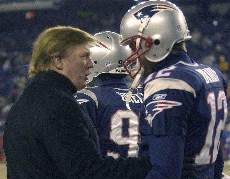 Donald Trump talks to Tom Brady before a game in 2004. (AP)