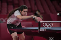 Syria's Hend Zaza competes during women's table tennis singles preliminary round match against Austria's Liu Jia at the 2020 Summer Olympics, Saturday, July 24, 2021, in Tokyo. (AP Photo/Kin Cheung)