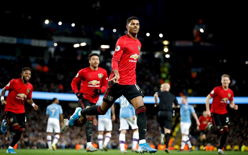 Manchester United's Marcus Rashford celebrates scoring his side's first goal of the game during the Premier League match at the Etihad Stadium, Manchester. (Photo by Martin Rickett/PA Images via Getty Images)