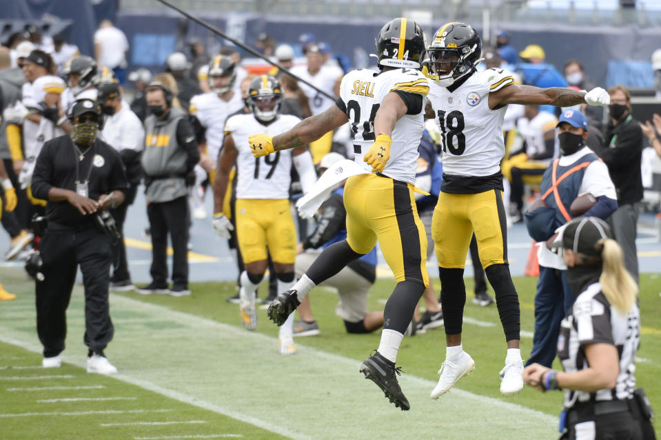 Pittsburgh Steelers running back Benny Snell (24) celebrates with wide receiver Diontae Johnson (18) after Snell scored a touchdown against the Tennessee Titans in the first half of an NFL football game Sunday, Oct. 25, 2020, in Nashville, Tenn. (AP Photo/Mark Zaleski)