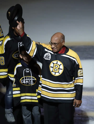 FILE - Former Boston Bruins' Willie O'Ree tips his hat as he is honored prior to the first period of an NHL hockey game against the Montreal Canadiens in Boston, in this Wednesday, Jan. 17, 2018, file photo. The Boston Bruins say they will retire the jersey of Willie ORee, who broke the NHLs color barrier. ORee will have his No. 22 jersey honored prior to the Bruins Feb. 18 game against the New Jersey Devils. He became the leagues first Black player when he suited up for Boston on Jan. 18, 1958 against the Montreal Canadiens, despite being legally blind in one eye. (AP Photo/Charles Krupa, File)