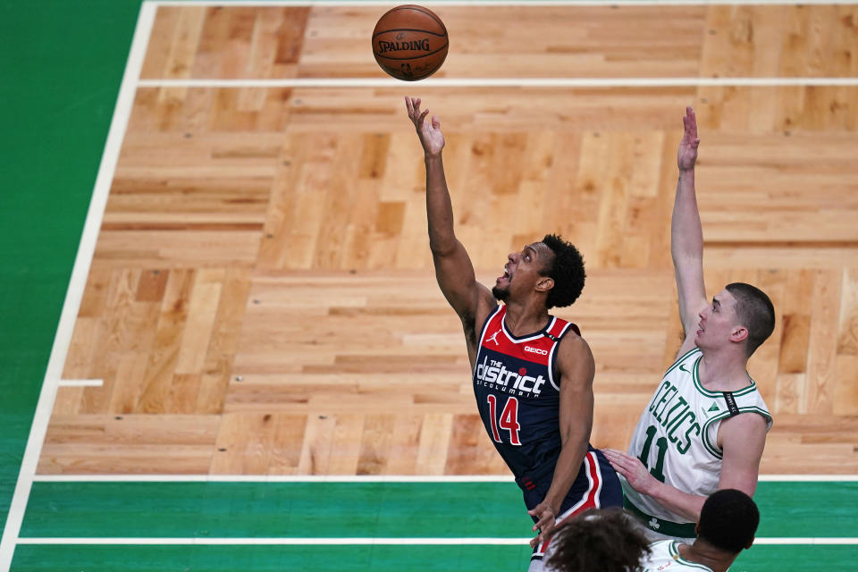Washington Wizards guard Ish Smith (14) drives to the basket past Boston Celtics guard Payton Pritchard (11) during the first half of an NBA basketball Eastern Conference Play-in game, Tuesday, May 18, 2021, in Boston. (AP Photo/Charles Krupa)
