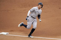New York Yankees' Aaron Judge rounds the bases on a solo home run off Minnesota Twins pitcher Randy Dobnak during the first inning of a baseball game Wednesday, June 9, 2021, in Minneapolis. (AP Photo/Jim Mone)