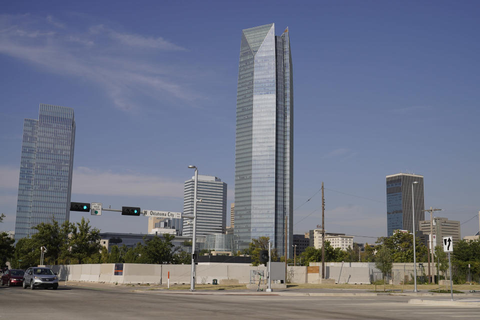 The Devon Energy Tower is pictured Monday, Sept. 27, 2021, in Oklahoma City. Oklahoma City-based Devon Energy Corporation has agreed to a $6.15 million settlement agreement with the federal government over allegations it underpaid royalties on federal leases, the U.S. Department of Justice announced Monday. (AP Photo/Sue Ogrocki)