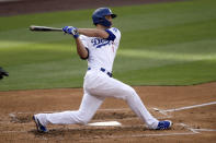 Los Angeles Dodgers' Corey Seager hits a triple against the San Diego Padres during the third inning of a baseball game in Los Angeles, Sunday, April 25, 2021. (AP Photo/Alex Gallardo)