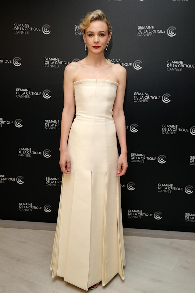 <p>At the photo call for <em>Wildlife</em>, Carey Mulligan looked typically elegant in a strapless Dior Couture number. The champagne hue against her red lip was an undeniable hit. (Photo: Getty) </p>