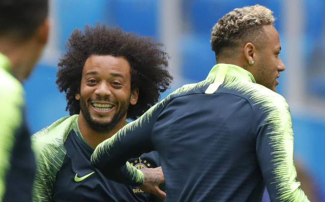 Brazil's Neymar, right, and Marcelo exercise during Brazil's official training on the eve of the group E match between Brazil and Costa Rica at the 2018 soccer World Cup in the St. Petersburg stadium in St. Petersburg, Russia, Thursday, June 21, 2018. (AP Photo/Dmitri Lovetsky)