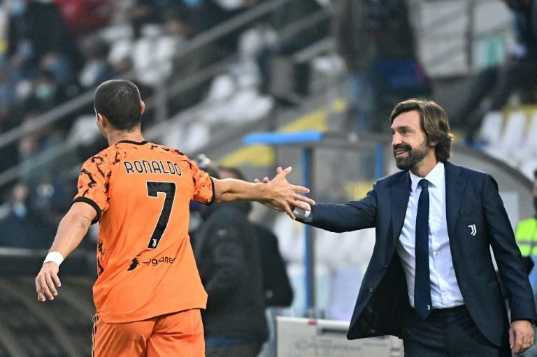 Cristiano Ronaldo (L) scored a double to ease the pressure on Juventus coach Andrea Pirlo (R)