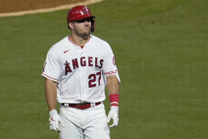 Los Angeles Angels' Mike Trout reacts after flying out to Arizona Diamondbacks right fielder Kole Calhoun during the fifth inning of a baseball game Tuesday, Sept. 15, 2020, in Anaheim, Calif. (AP Photo/Ashley Landis)