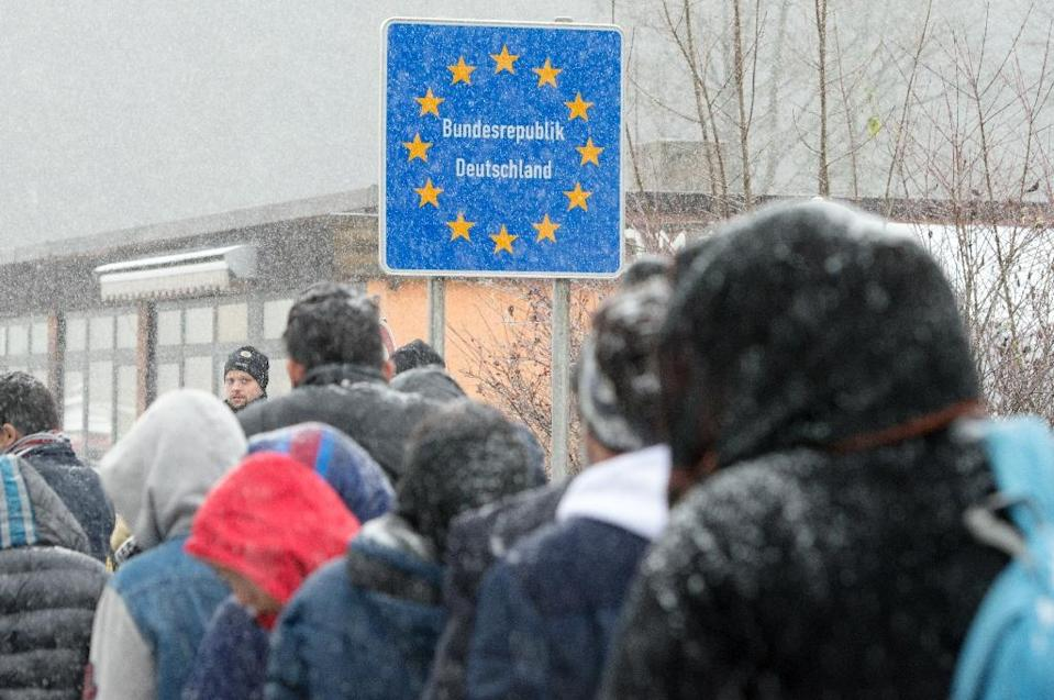 Migrants queue to enter Germany via the Austrian border in 2015, as Europe's top economy has been lifted by strong consumer spending and state spending on asylum seekers (AFP Photo/Armin Weigel)