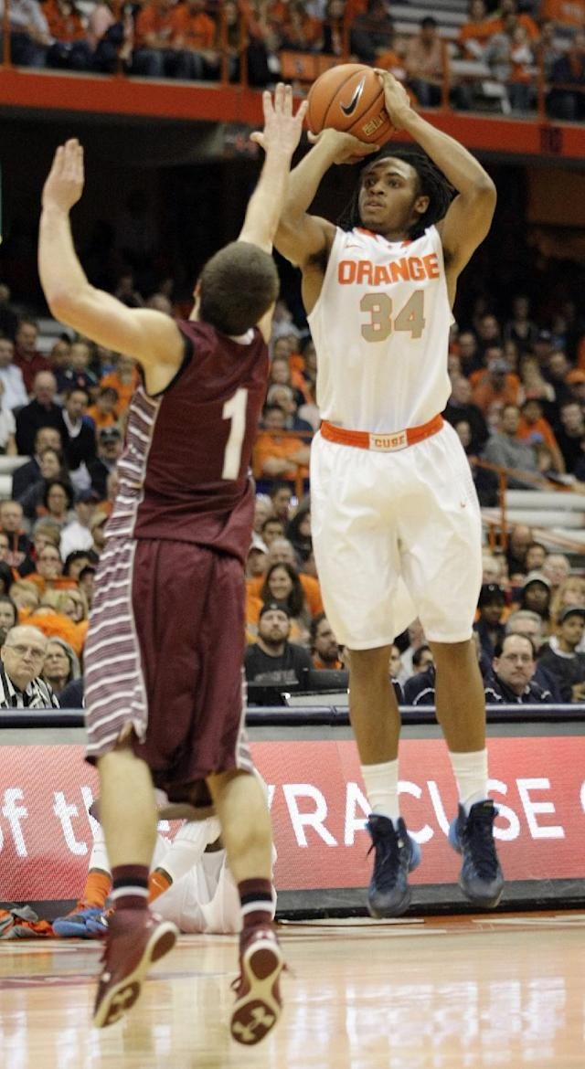 Syracuse's Ron Patterson, right, shoots over Colgate's Auston Tillotson in the second half of an NCAA college basketball game in Syracuse, N.Y., Saturday, Nov. 16, 2013. Syracuse won 69-50. (AP Photo/Nick Lisi)
