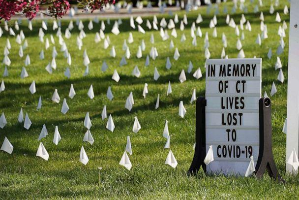 PHOTO: Thousands of white markers, are seen on the lawn, placed by Rev. Patrick Collins, at the First Congregational Church of Greenwich, May 4,2020, to honor the many lives lost as result of the COVID-19 pandemic in Old Greenwich, Ct. (Timothy A. Clary/AFP via Getty Images)