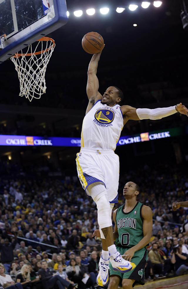 Golden State Warriors' Andre Iguodala (9) goes up for a dunk next to Boston Celtics' Avery Bradley (0) during the second half of an NBA basketball game on Friday, Jan. 10, 2014, in Oakland, Calif. Golden State won 99-97. (AP Photo/Marcio Jose Sanchez)