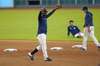 Houston Astros first baseman Yuli Gurriel reacts after completing a drill during a baseball practice at Minute Maid Park, Sunday, July 5, 2020, in Houston. (AP Photo/David J. Phillip)