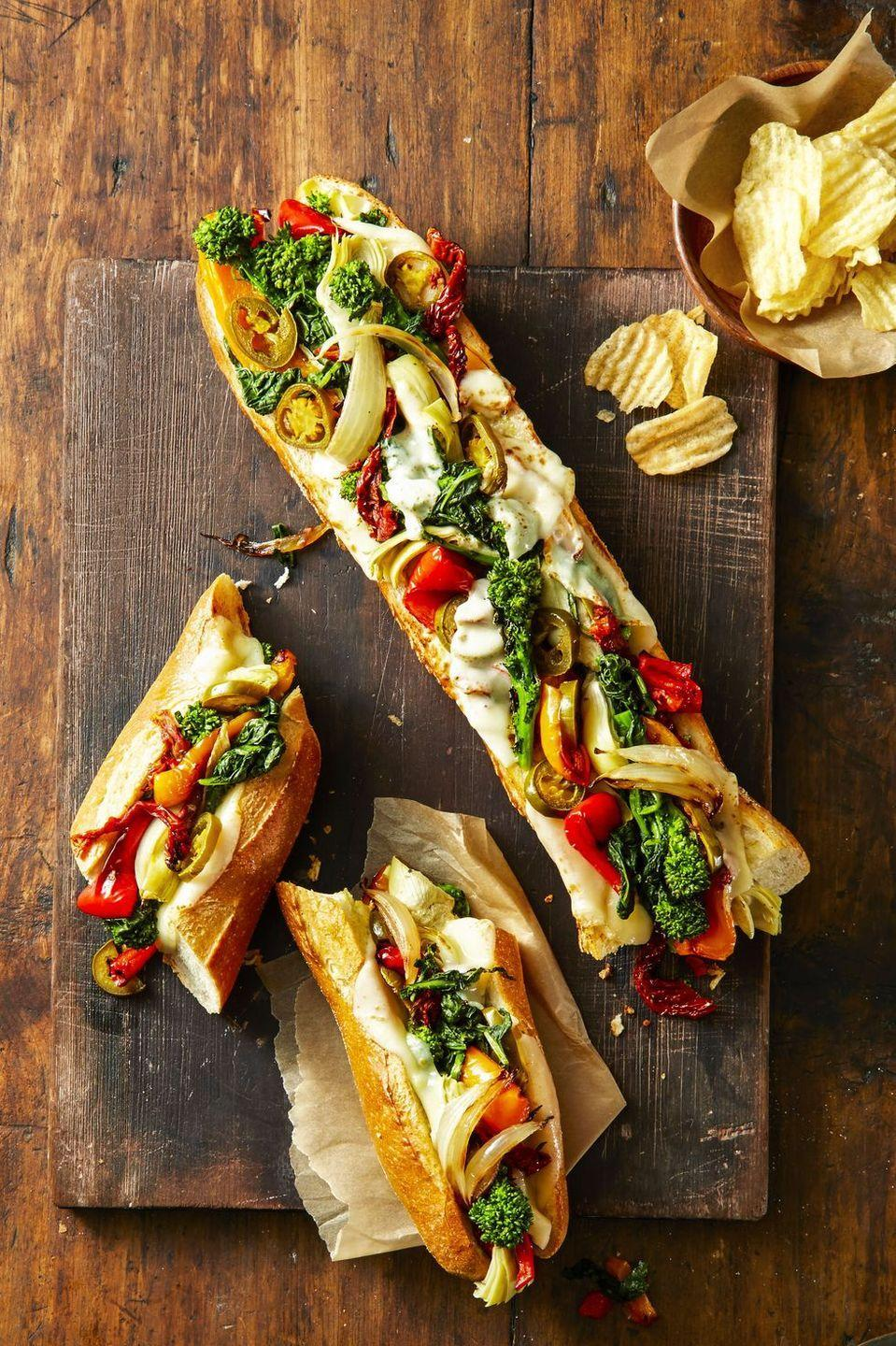 "<p>Instead of blanching broccolini, roast with the other veggies. Who knew dinner for a crowd could be so simple (and so tasty)?</p><p><em><a href=""https://www.goodhousekeeping.com/food-recipes/a42217/provolone-veggie-party-subs-recipe/"" rel=""nofollow noopener"" target=""_blank"" data-ylk=""slk:Get the recipe for Provolone Veggie Party Subs »"" class=""link rapid-noclick-resp"">Get the recipe for Provolone Veggie Party Subs »</a></em><br></p>"