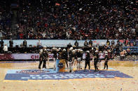 Stanford players celebrate on the court after the championship game against Arizona in the women's Final Four NCAA college basketball tournament, Sunday, April 4, 2021, at the Alamodome in San Antonio. Stanford won 54-53. (AP Photo/Morry Gash)
