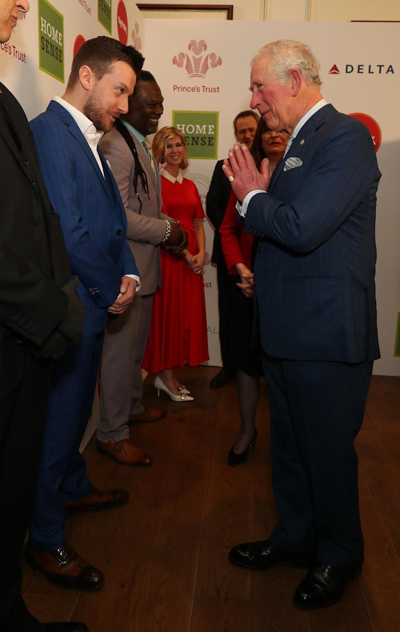 The Prince of Wales greets Chris Ramsey with a Namaste gesture as he arrives at the annual Prince's Trust Awards 2020 held at the London Palladium.