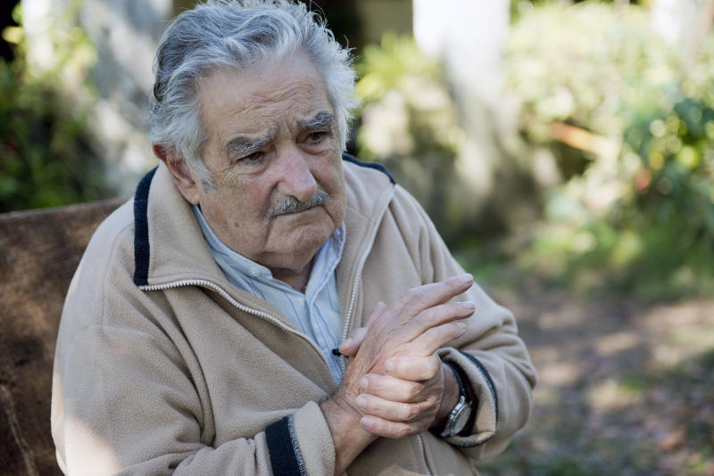 "Uruguay's President Jose Mujica pauses during an interview at his home on the outskirts of Montevideo, Uruguay, Friday, May 2, 2014. Mujica says the country's legal marijuana market will be much less permissive with drug users. ""We don't go along with the idea that marijuana is benign, poetic and surrounded by virtues. No addiction is good,"" he said. In an exclusive Associated Press interview just before releasing his country's long-awaited marijuana rules, the former leftist guerrilla predicted that many will call him an ""old reactionary"" once they see the fine print. (AP Photo/Matilde Campodonico)"