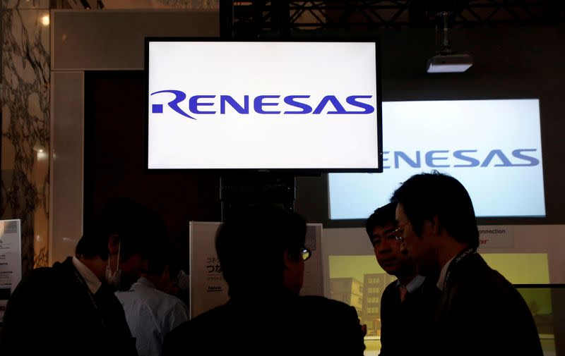 FILE PHOTO: FILE PHOTO: Renesas Electronics Corp's logos are pictured at the company's conference in Tokyo