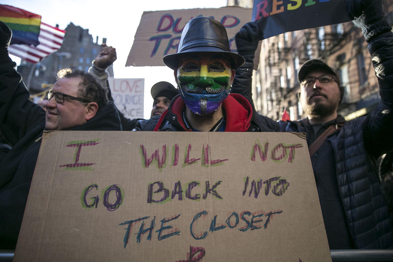 <p>A protester wears a Guy Fawkes mask in rainbow colors at a rally in solidarity with immigrants, asylum seekers, refugees, and the LGBT community, Feb. 4, 2017 in New York. (Photo: Gordon Donovan/Yahoo News) </p>