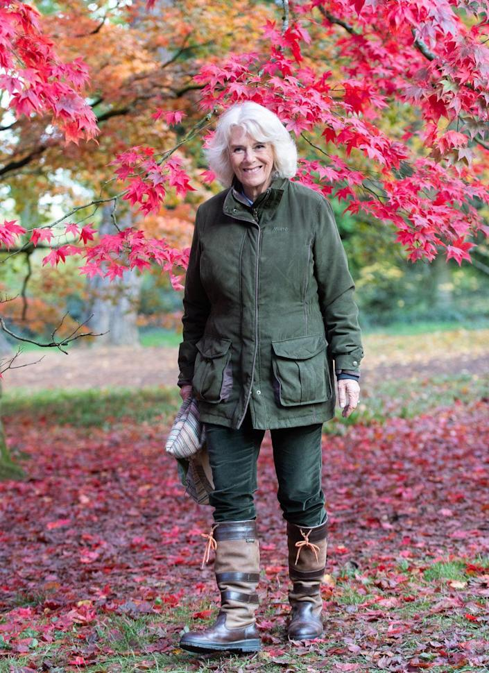 <p>Wearing a classically British, outdoorsy look, the Duchess of Cornwall embraced a beautiful fall day at the National Arboretum in Tetbury, England.</p>