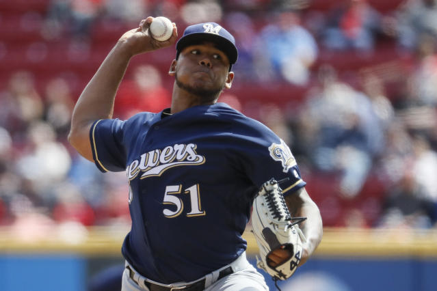 Milwaukee Brewers starting pitcher Freddy Peralta throws in the eighth inning of a baseball game against the Cincinnati Reds, Wednesday, April 3, 2019, in Cincinnati. (AP Photo/John Minchillo)