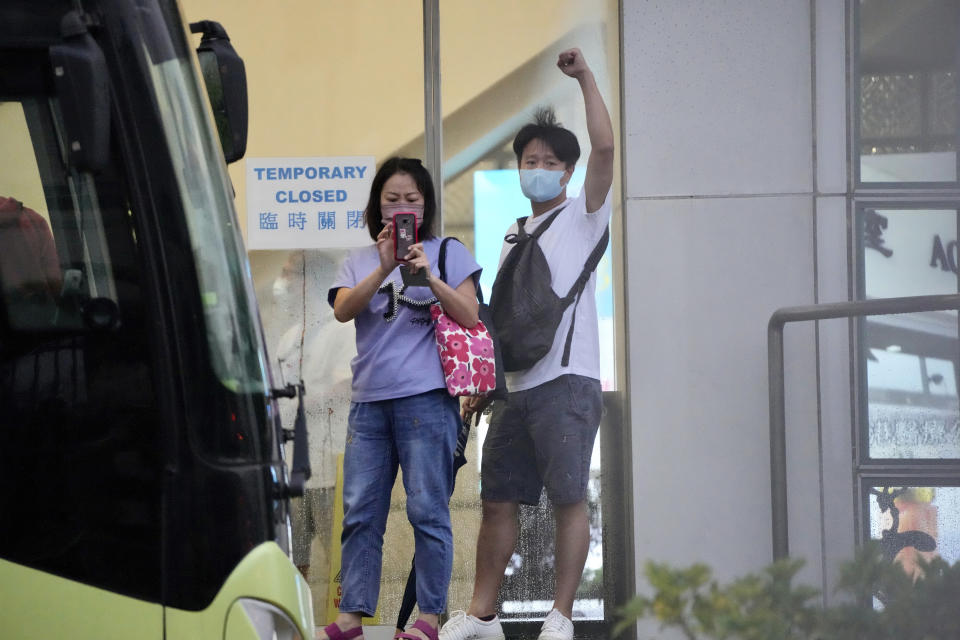 A staff member shows a sign of thanks for their supporters at the Apple Daily headquarters in Hong Kong, Wednesday, June 23, 2021. Hong Kong's pro-democracy Apple Daily newspaper will stop publishing Thursday, following last week's arrest of five editors and executives and the freezing of $2.3 million in assets under the city's one-year-old national security law. (AP Photo/Kin Cheung)