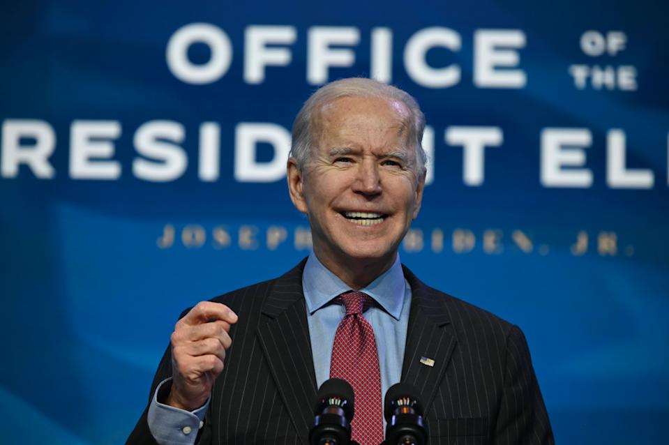 US President-elect Joe Biden speaks at The Queen theater in Wilmington, Delaware on January 8, 2021, to announce key nominees for his economic and jobs team. - Biden and Harris announced on January 8, 2021 the following nominees for their economic and jobs team: for Secretary of Commerce, Rhode Island Governor Gina Raimondo; for Secretary of Labor, Boston Mayor Marty Walsh; for Small Business Administrator, California official Isabel Guzman; and for Deputy Secretary of Commerce, Biden's former counselor Don Graves. (Photo by JIM WATSON / AFP) (Photo by JIM WATSON/AFP via Getty Images)