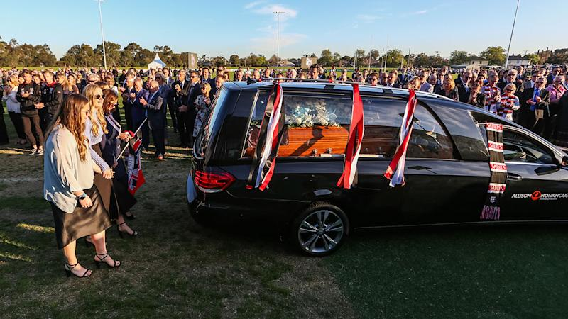 The Hearse carrying the coffin of Danny Frawley, pictured here during his farewell lap of honour.