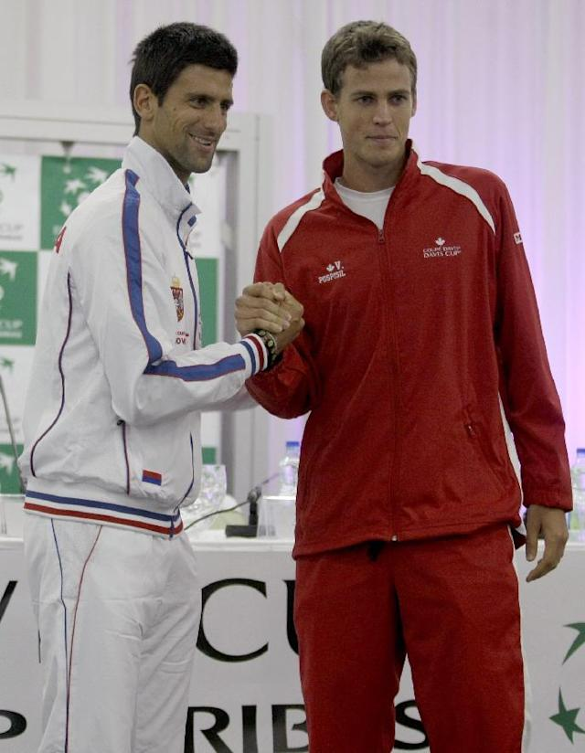 Novak Djokovic of Serbia, left, and Vasek Pospisil of Canada pose for a photograph during the Davis Cup semifinals draw ceremony in Belgrade, Serbia, Thursday, Sept. 12, 2013. Serbia will face Canada in the 2013 Davis Cup semifinal that starts on Friday, Sept. 13 in Belgrade. (AP Photo/ Marko Drobnjakovic)
