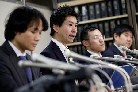 Lawyers representing a group of seven people who had invested in digital money at Coincheck, attend a news conference after they filed a suit at the Tokyo District Court, in Tokyo, Japan, February 15, 2018. REUTERS/Toru Hanai
