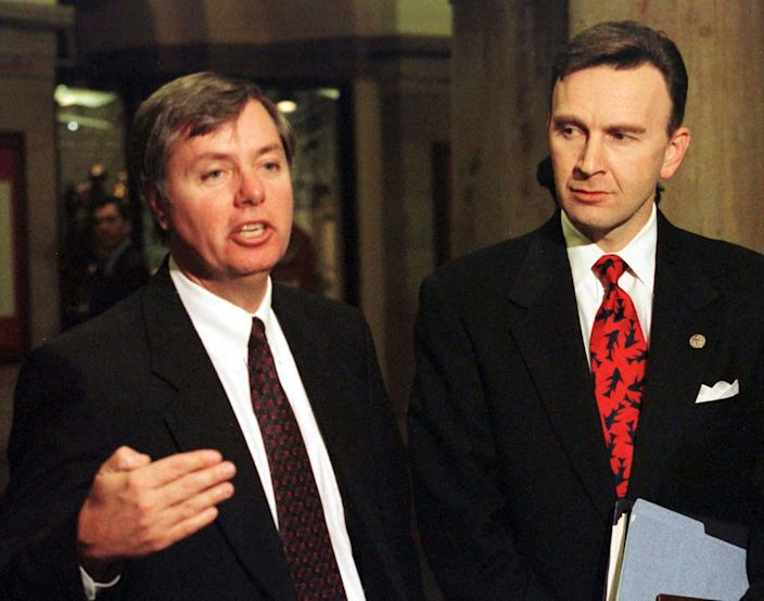 Republican Reps. Lindsey Graham and James Rogan speak to the press during the Senate impeachment trial of President Bill Clinton in February 1999. (Photo: Reuters)