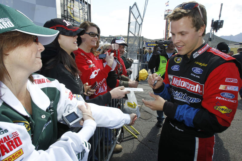 Daytona 500 winner Trevor Bayne signs autographs before the NASCAR Sprint Cup Series auto race at Phoenix International Raceway on Sunday, Feb. 27, 2011, in Avondale, Ariz. Bayne finished 40th in Sunday's race. (AP Photo/Ross D. Franklin)