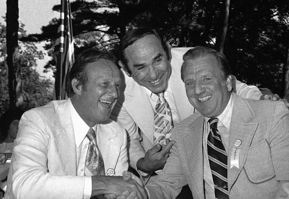 FILE - In this Aug. 18, 1975 file photo, Stan Musial, left, Yogi Berra, center, and Ralph Kiner, share a laugh after Kiner was inducted into the Baseball Hall of Fame in Cooperstown, New York. The baseball Hall of Fame says slugger Ralph Kiner has died. He was 91. The Hall says Kiner died Thursday, Feb. 6, 2014, at his home in Rancho Mirage, Calif. (AP Photo/Ray Howard, File)