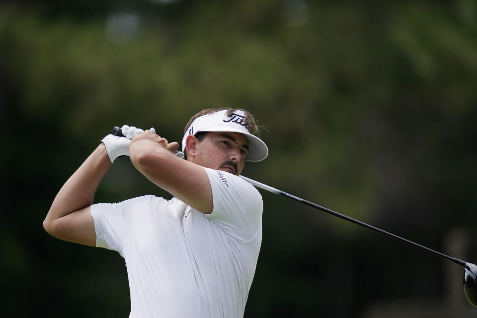 Hank Lebioda drives off the fourth tee during the third round of the Rocket Mortgage Classic golf tournament, Saturday, July 3, 2021, at the Detroit Golf Club in Detroit. (AP Photo/Carlos Osorio)
