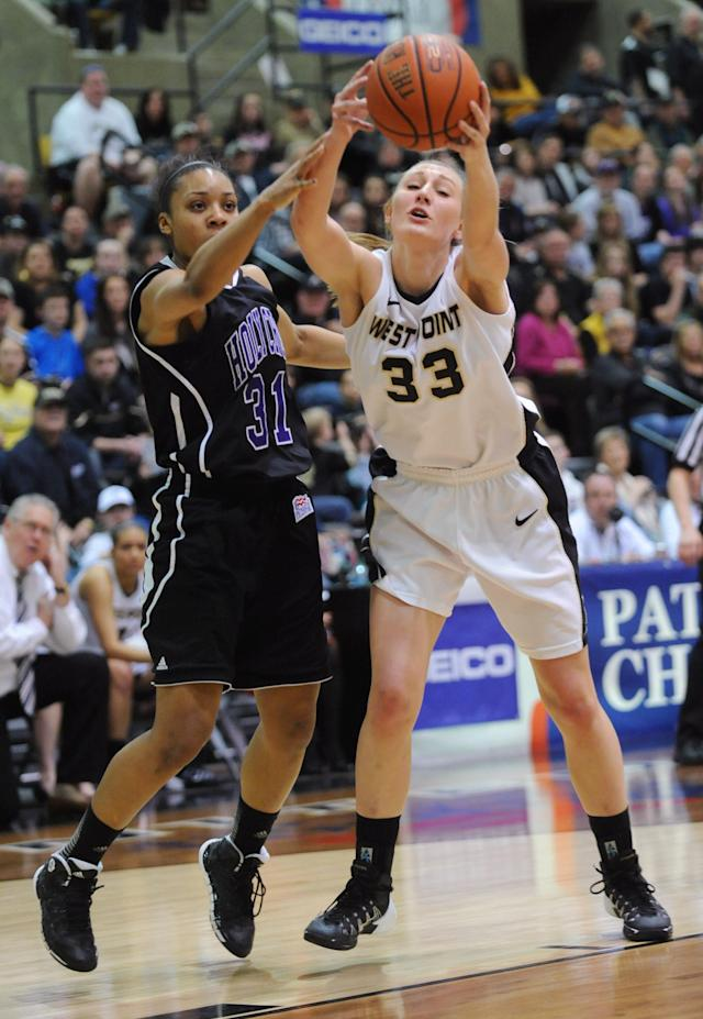Holy Cross' Raquel Scott (31) and Army's Aimee Oertner (33) compete for a rebound during the first half of an NCAA college basketball game in the Patriot League Championship at Christi Arena, Saturday, March 15, 2014, at West Point, N.Y. (AP Photo/Karl Rabe)