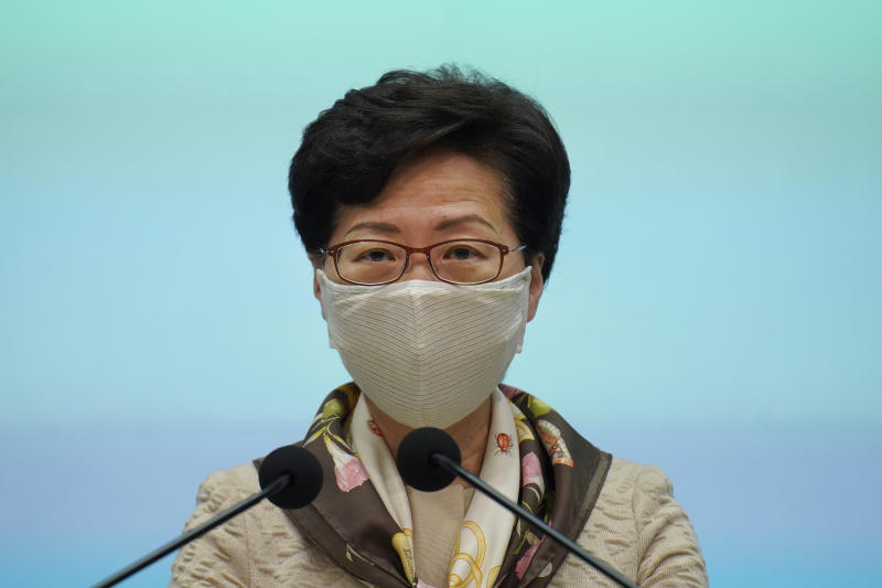 "Hong Kong Chief Executive Carrie Lam listens to reporters questions during a press conference in Hong Kong, Tuesday, June 2, 2020. Lam hit out at the ""double standards"" of foreign governments over national security, and pointed to recent unrest in America as an example. (AP Photo/Vincent Yu)"