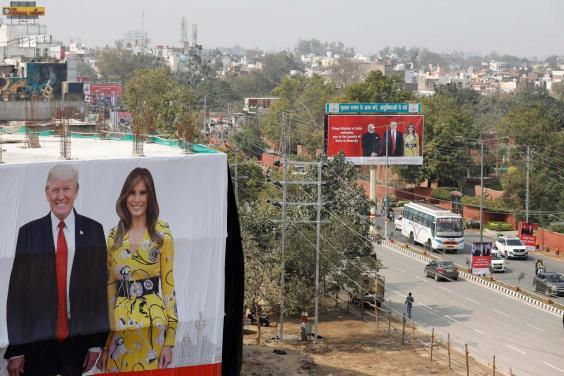 A billboard featuring President Trump and first lady Melania Trump erected to welcome them ahead of their visit to the Taj Mahal (AP)
