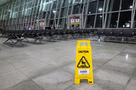 A safety sign is seen in an empty section of the arrivals area of Terminal 4 following a water main break that closed part of the terminal at John F. Kennedy International Airport in New York City, U.S. January 7, 2018.  REUTERS/Andrew Kelly