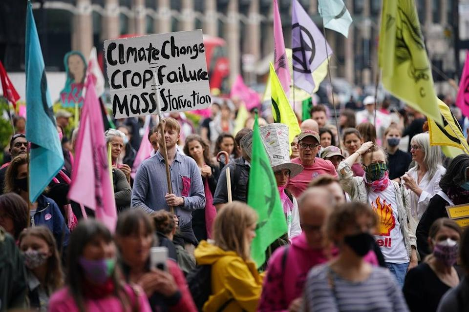 """Extinction Rebellion demonstrators in Parliament Square, London, during the protest group's """"free the press"""" campaign. Picture date: Sunday June 27, 2021. (PA Wire)"""